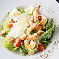 Caesare salad, with grilled king prawns