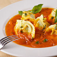 Tortelloni stuffed with spinach and ricotta, in a basil tomato sauce