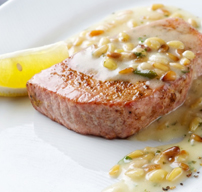 Red tuna steak grilled with pine nuts and lemon butter